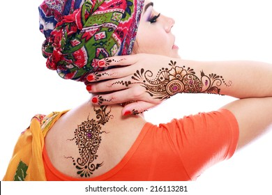 Beautiful woman arabian make up and turban on head with detail of henna being applied to hand and backt isolated