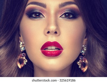Beautiful woman with arabic make-up, red lips and curls. Beauty face. Insta Color