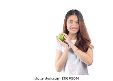 Beautiful woman asia with a happy smile, holding fresh green apples in hand, isolated on white background
