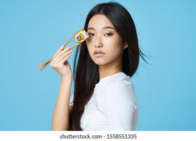 Beautiful woman of Asian appearance chopsticks diet seafood