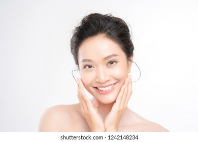 Beautiful woman asian face close up studio .She is holding her cheeks.