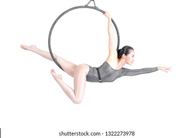 Beautiful woman Asian sport girl  fly yoga posing on hoop isolated white background , Aerialist gymnastics performs physical exercises - yoga concept