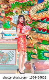Beautiful woman Asian wearing red dress in Chinese New Year