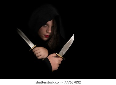 Beautiful woman assassin, dark lighting, mood photo.