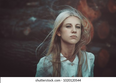 Beautiful woman in autumn wind. Flying hair
