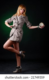 beautiful woman in autumnal coat with alarm clock