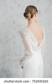 A beautiful woman in a  backless dress