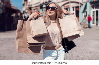 Beautiful woman with bags, shopping concept