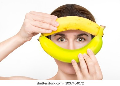 Beautiful woman with bananas in her hands