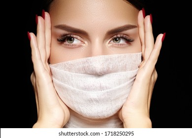 Beautiful woman with bandage mask on face. Fashion eye make-up, long eyelashes and perfect shade eyebrows. Beauty plastic surgery or protection hygiene in viral covid-19 pandemic