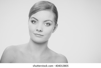 Beautiful woman with bare shoulders. Attractive girl with perfect clean skin.   Black and white photo.