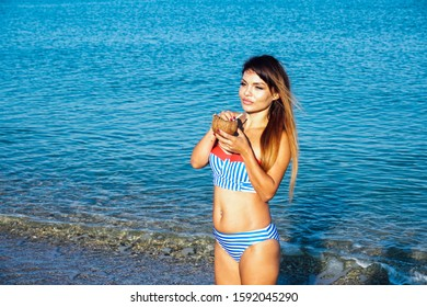 a beautiful woman in a bathing suit in the winter in the South