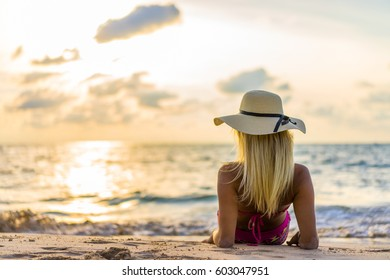 Beautiful Woman at the beach at sunset  in Thailand