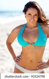 Beautiful woman at the beach wearing a bikini