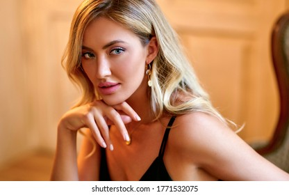 Beautiful Woman With Beauty Face Makeup. Portrait Of Attractive Female Touching Smooth Facial Skin With Hand. Closeup Sexy Girl Model With Fresh Natural Makeup And Glamour Hairstyle. High Resolution