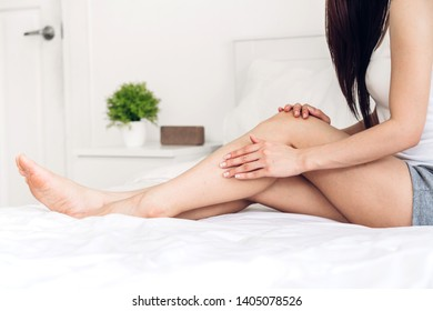 Beautiful woman beauty health care.beauty and spa.perfect fresh skin.Woman applying moisturizing cream on long legs at home