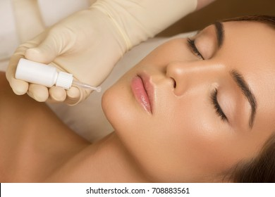 Beautiful woman in beauty salon during skincare treatment