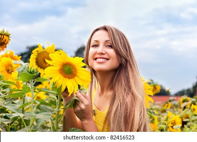 beautiful woman between sunflowers
