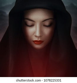 Beautiful woman big eyes covers her face with a black cloth. Red lips girl under hood. In colorful bright lights