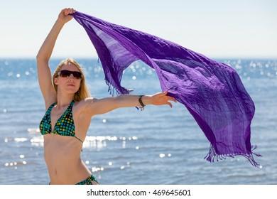 Beautiful woman in a bikini enjoying herself at the beach