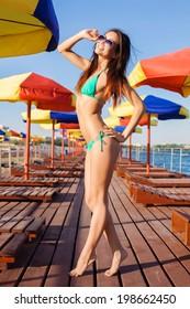 Beautiful  woman in bikini at summer