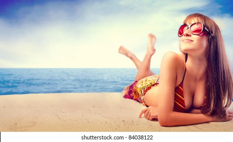 Beautiful woman in bikini sunbathing at the seaside
