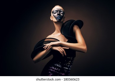 beautiful woman in black dress with mask