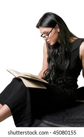 Beautiful woman in a black dress reading a book