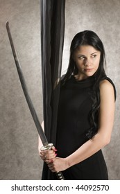 Beautiful woman in a black dress and a sword.
