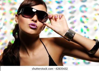 Beautiful  woman in the black fashion sunglasses touching it - pouting sexy lips