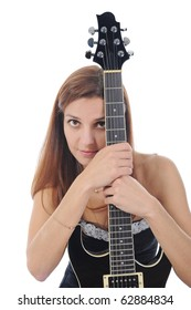 beautiful woman with a black guitar in his hand. Isolated on white background