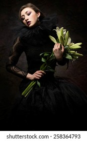 Beautiful woman in black lace dress with lilly flowers
