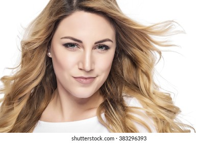 Beautiful woman with blond hair. Fashion model posing at studio.