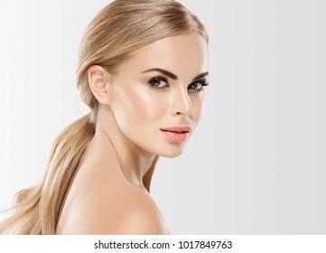 Beautiful woman blonde hair face close up portrait studio on white