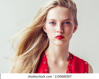 Beautiful woman blonde hair and red lips  dress over white background natural female portrait
