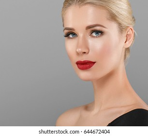 Beautiful Woman Blonde Hairstyle face with red lips portrait. Healthy skin and perfect makeup. Studio shot.