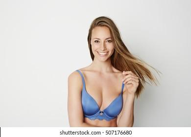 Beautiful woman in blue bra, smiling