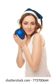 Beautiful woman in blue cap with christmas ball smiling