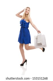 Beautiful woman in a blue dress with shopping bags, isolated on a white background