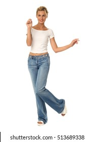 Beautiful woman in blue jeans with bun blonde hair isolated