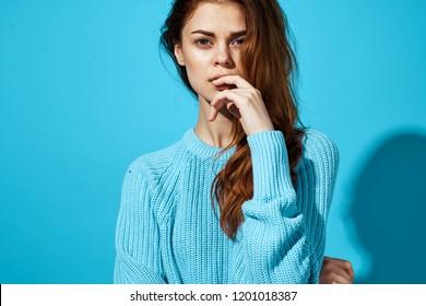 Beautiful woman in blue sweater