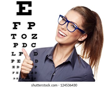 beautiful  woman with blue trendy glasses on the background of eye test chart