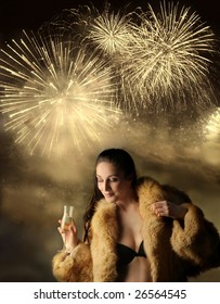 beautiful woman in bra and fur, drinking wine on a fireworks background