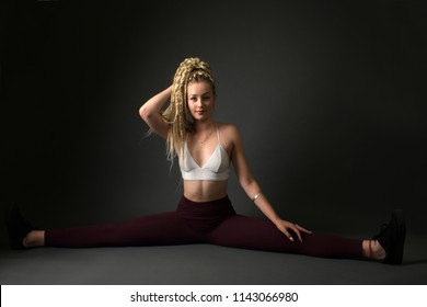Beautiful woman with braids hairstyle. Dancehall dancer.