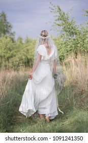Beautiful woman - the bride. Boho style woman. Barefoot beautiful woman on the clearing. Natural, Nymph.
