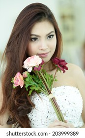 Beautiful woman as bride with bouquet