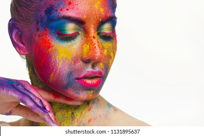Beautiful woman with bright colorful art make-up, creative design and beauty salon advertisement