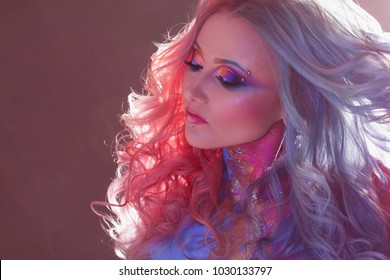 Beautiful woman with bright hair. Bright hair color, hairstyle with the curls.