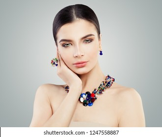 Beautiful woman with bright jewelry ring, necklace and earrings, fashion portrait