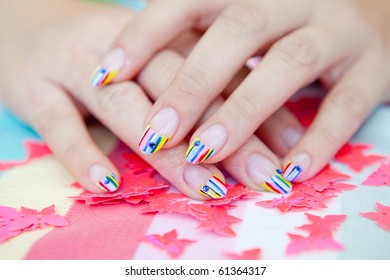 A beautiful woman with bright manicure long nails